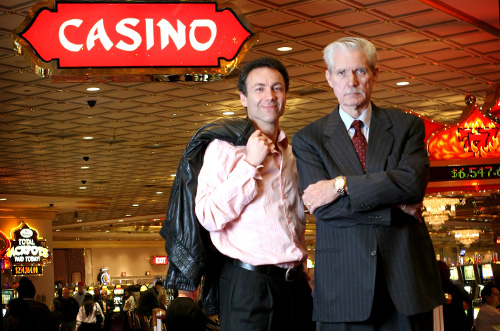Richard Marcus (left) is posing outside of Taj Mahal Casino with a friend.